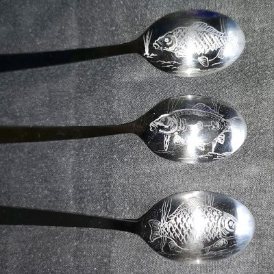 Teaspoons engraved with fishing themes